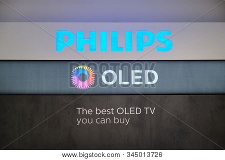 Bucharest, Romania - December 22, 2019: Philips And Oled Logos Displayed In Emag Showroom, In Buchar