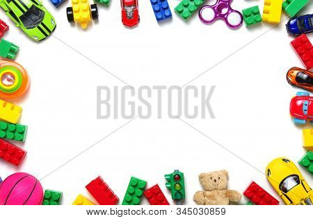 Kids toys frame on white background. Top view. Copy space for text
