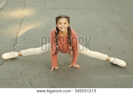 Pilates For Health Resolution. Small Girl Do Splits Outdoor. Little Child Enjoy Pilates Workout. Pil