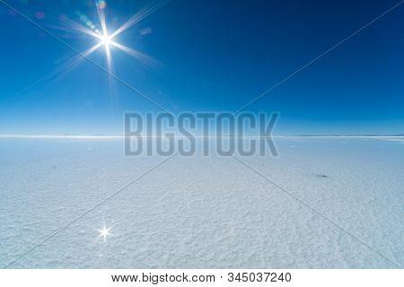 Salar de Uyuni salt flat with thin water layer, Bolivia