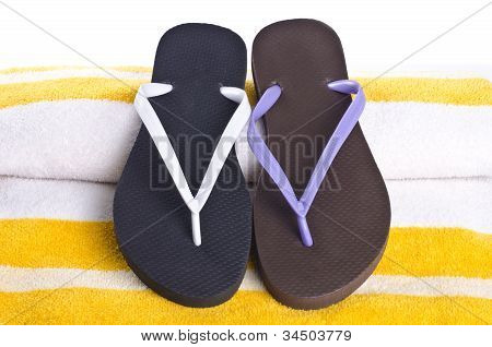 Mismatched Flip Flop on Colorful Beach Towel