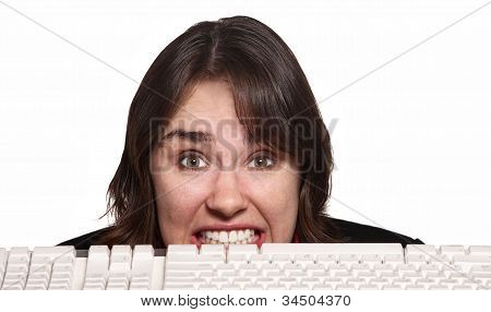 Nervous Woman Behind Keyboard