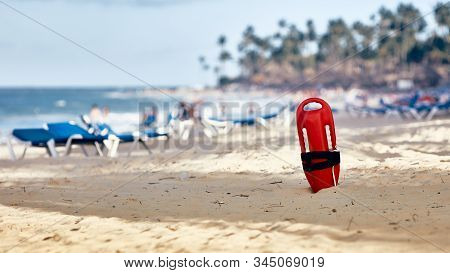 Lifeguard Standing In The Sand. Lifeguard Float.