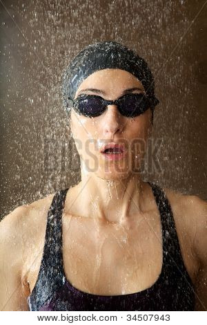 Woman With Goggles Under Water Drops
