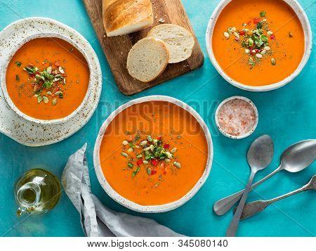 Gaspacho Soup On Blue Tabletop. Three Bowls Of Traditional Spanish Cold Soup Puree Gaspacho Or Gazpa