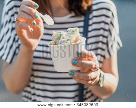 Rolled Ice Cream In Cone Cup In Woman Hands. Woman In Striped Dress Holds Cone Cup With Thai Style K