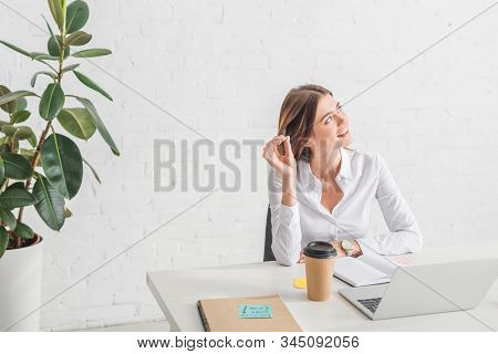 Happy Businesswoman Chilling And Dreaming In Office