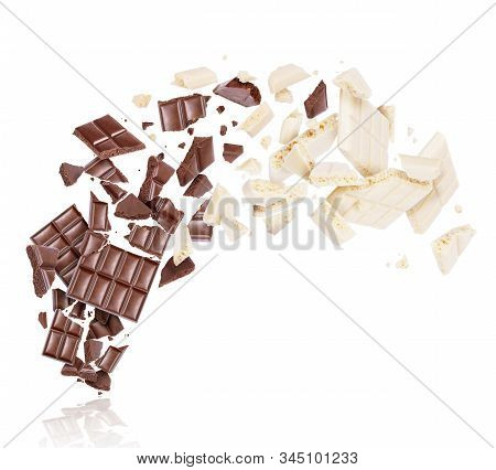 Porous Dark And Milk Chocolate Broken Into Many Pieces In The Air
