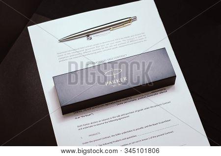 Izmail, Ukraine, January 12, 2020: Parker Pen And Documents On A Black Background