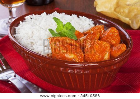 Chicken curry and rice as served in a pub in an old pie dish. poster