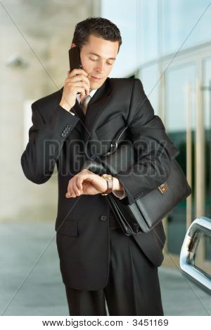 Businessman Outside A Modern Building