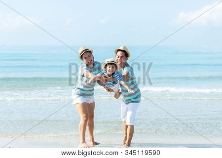 Asian Happy Family Have Fun Fly On The Beach For Leisure And Destination.  Family People Tourism Tra