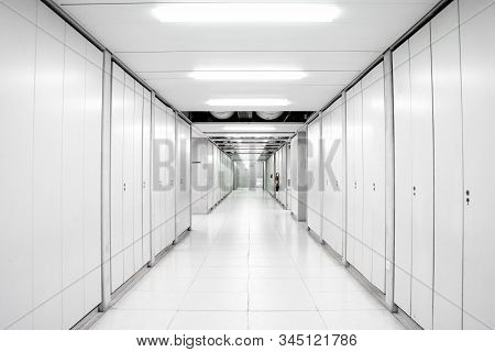 Industrial Building Science Laboratory Empty Corridor Hallway Illuminated By Neon Lights With Locker