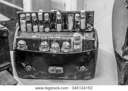 Vintage Medicine Bag. Black And White Leather Doctor Bag With Several Glass Bottles Of Herbs, Tinctu