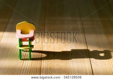 Empty Highchair For Wooden Background. Infertility Concept, Lack Of Children In The Family, Empty Hi