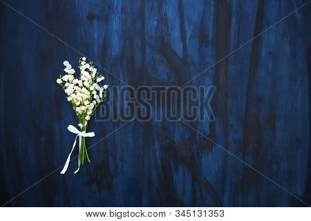Wonderful Fragrant White Flowers With A Delicate Scent. Lily Of The Valley Flowers On Black Wooden T