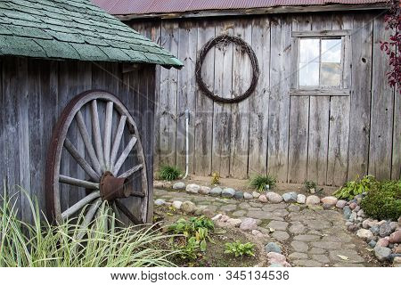 Country Garden Shed. Winding Stone Path Among Gardeners Shed And Outbuildings.