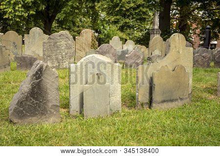 Old Gravestones Cluster Ruins In Cemetery Graveyard