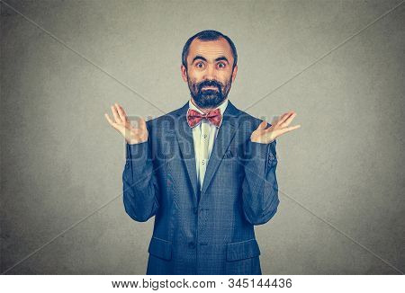 Ignorance And Arrogance. Closeup Portrait Young Man Shrugging Shoulders Who Cares So What I Do Not K