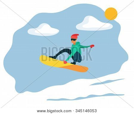 Man Sliding On Snowboard On Mountain Hill. Snowboarder Doing His Hobby. Snowboarding Or Extreme Spor