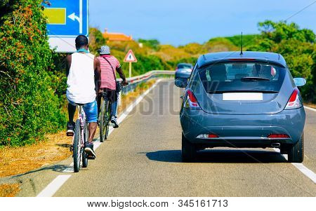 Bicycles And Cars In The Road In Costa Smeralda Reflex