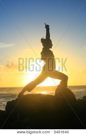 Yoga posed image against the sunrise on the beach. poster