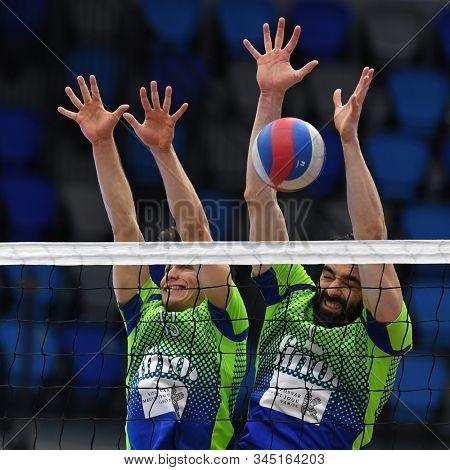 KAPOSVAR, HUNGARY – JANUARY 12, 2020: Jozsef Nagy (r) blocks the ball at a Hungarian National Campionship volleyball game between Kaposvar (blue) and Kecskemet (white) in Kaposvar Arena, Kaposvar.