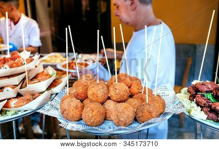 Palermo, Italy: Arancini For Hungry Customers Of Street Market, Tasty Stuffed Rice Balls, Traditiona