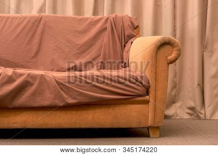 Old Beige Sofa. Crumpled Blanket On The Couch. Modern Style. Cushioned Furniture. Furniture For Rest