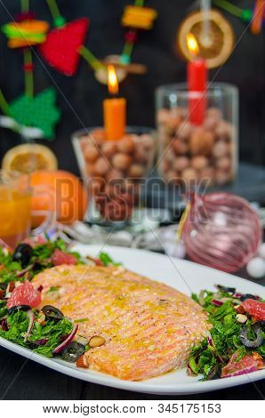 Oven Baked Salmon With Grapefruit Salad. Red Fish Steak Served With Salad And Olive Oil On Plate Wit