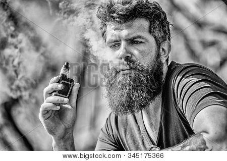 Man With Beard Breathe Out Smoke. Clouds Of Flavored Smoke. Bearded Man Smoking Vape. Smoking Electr