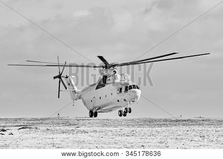 Transport Helicopter Mi-26 Tc In Flight. Heavy Helicopter In Winter. Parking Lot On The Codification