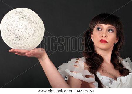 Woman Holding White Light Ball