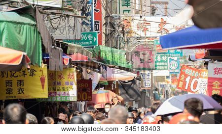 Puli, Taiwan - October 11th, 2019: people walk and shopping in the traditional market at Puli town, Nantou county, Taiwan