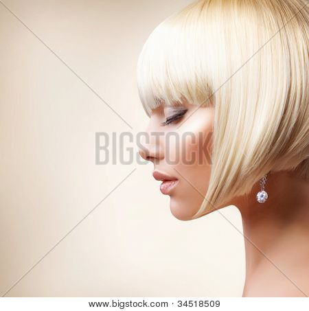 Blond Hair.Haircut. Beautiful Girl with Healthy Short Hair. Hairstyle