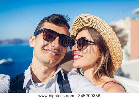 Valentines Day. Couple In Love Taking Selfie During Honeymoon In Santorini Island, Greece. People Wa