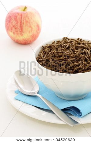 healthy breakfast  with fresh apple and wheat bran cereal