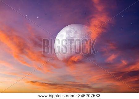 Moon In Bright Clouds Of Sunset Sun .   The Sky At Night With Stars.