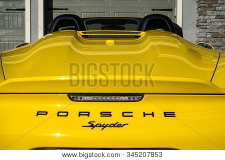 Orlando, Fl/usa-1/15/20: The Rearend Of A Yellow Porsche Spyder Sitting In Front Of A Home.