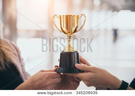 Champion Golden Trophy For Winner Background. Success And Achievement Concept. Sport And Cup Award T