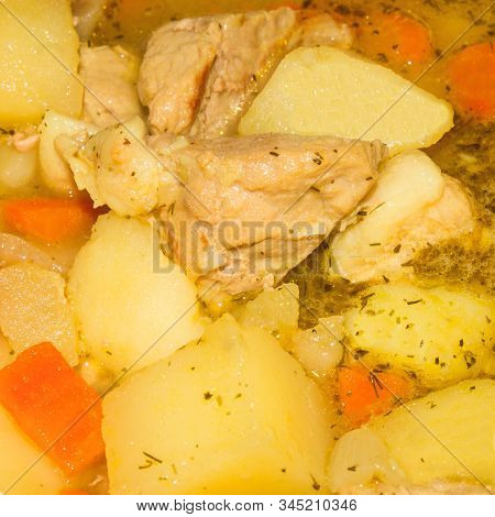 Potatoes With Meat In A Thick Broth.stewed Potatoes With Meat.background Of Potatoes With Meat In Br