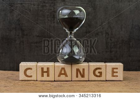Change, Transform Or Evolve To Success In Disruption World Concept, Sand Glass Or Hourglass On Cube