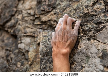 A Close Up Shot On The Fingers Of A Male Rock Climber, Struggling To Find A Stable Grip Position On