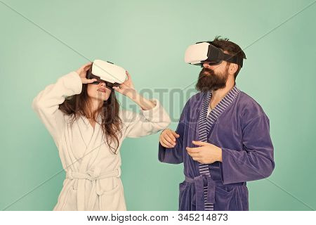 Girl And Man Hipster Relax In Bathrobe. Future Is Now. Digital Couple. Innovation In Family Relation