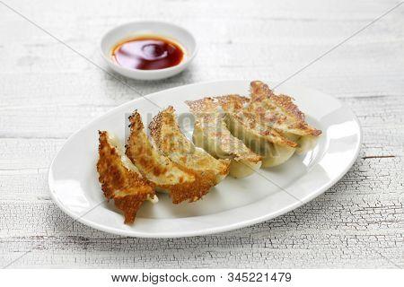 yaki gyoza, pot stickers, japanese style pan fried dumplings