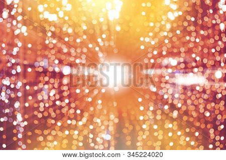 Abstract Blurred Of Colourful Bokeh Glittering Lights Holiday Festival Background.
