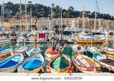 Nice, France - January 1, 2020: View Of Multi-colored Boats In The Warm Sunlight In The Port Lympia.