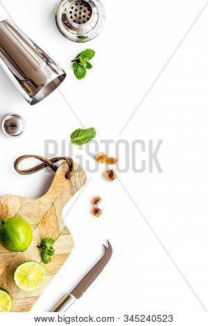 Bar Background. Tools And Ingredients For Making Cocktails. Shaker, Lime On Cutting Board On White B