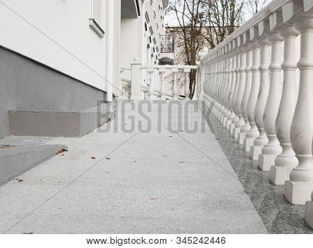White Railing. Beautiful Vintage White Concrete Balcony Railing.