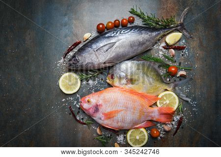 Fresh Fish With Herbs Spices Rosemary And Lemon Garlic Tomato For Cooked Food / Raw Fish Red Tilapia